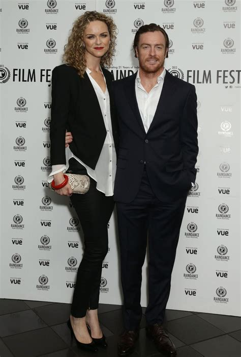 Toby Stephens and his wife Anna-Louise Plowman arriving