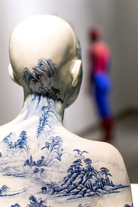 Porcelain Busts Imprinted with Chinese Decorative Designs